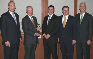 Truckworx Kenworth was named Kenworth's 2012 Parts and Service Dealer of the Year for the United States and Canada. From left, are Darrin Siver, PACCAR vice president and PACCAR Parts general manager; Truckworx Kenworth executives Bob Mitchell and Will Bruser; Tony McQuary, PACCAR Parts general sales manager; and Gary Moore, Kenworth general manager and PACCAR vice president.