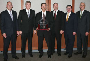 CIT Group was named the 2012 TRP All-Makes Kenworth Dealer of the Year for the United States and Canada. From left, are Darrin Siver, PACCAR vice president and PACCAR Parts general manager; CIT Group executives Erick Miner, Carl Herzog and Bruce Thomas; Tony McQuary, PACCAR Parts general sales manager; and Gary Moore, Kenworth general manager and PACCAR vice president.