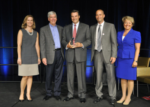 Tim Sinden (center), president of Eaton's North America Truck operations, receives Michigan's Corporate Community Leader Service Award from Governor Rick Snyder (2nd from left) in recognition of the volunteerism and other charitable efforts made by employees at Eaton's Galesburg, Mich., facility.