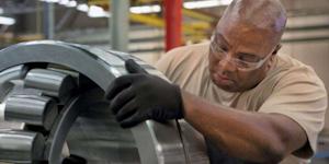 Timken associate Patrick Garner inspects a spherical roller bearing.