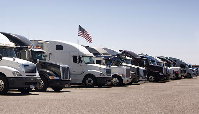 Stock image of a line of parked trucks.
