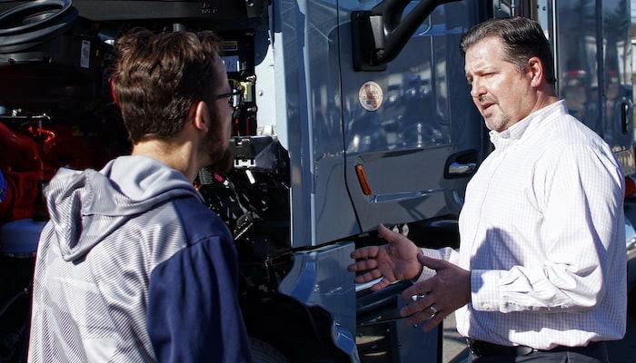 Hunter Truck Sales Rep Talking To Customer