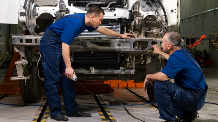 diesel techs working on truck