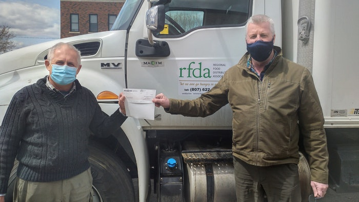 Volker Kromm, executive director of the Regional Food Distribution Association (on left) accepts a $5,000 donation cheque from Darrin Poulin, general manager of Maxim Truck & Trailer's Thunder Bay branch office.