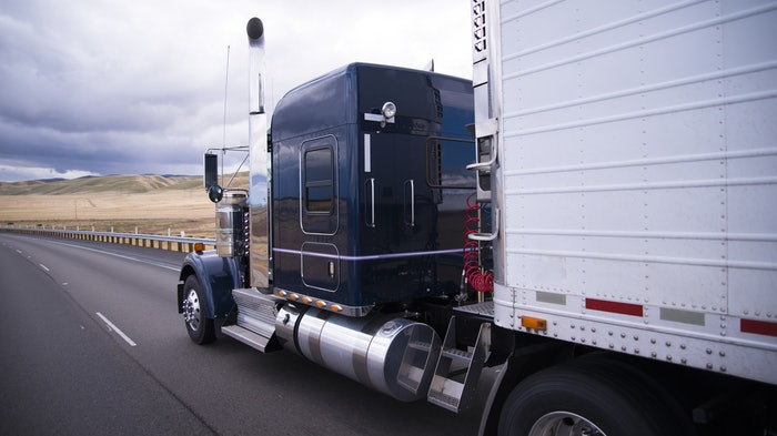 Truck and trailer on highway