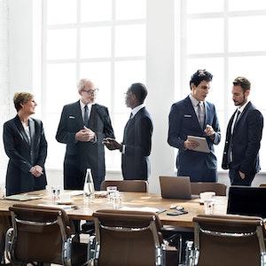 Executives at negotiating table