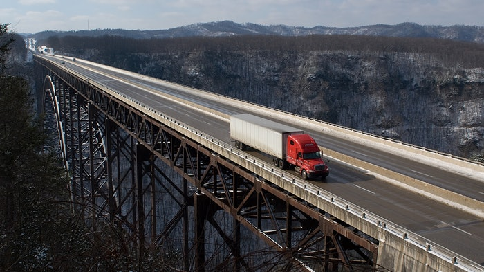 Truck driving across bridge