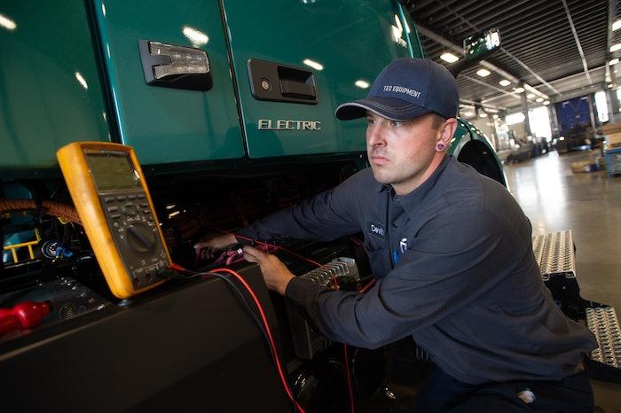 TEC Equipment technician servicing a Volvo VNR electric
