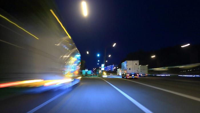Stylized image of trucks driving