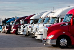 Trucks parked in a lot.