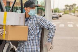Masked up man delivering parts.