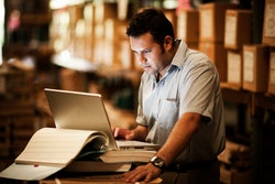Warehouse worker on laptop