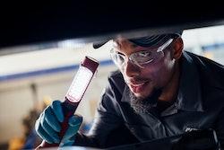 Technician under the hood
