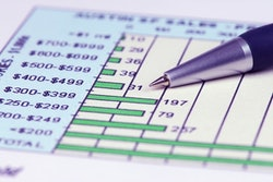 Image of spreadsheet and pen