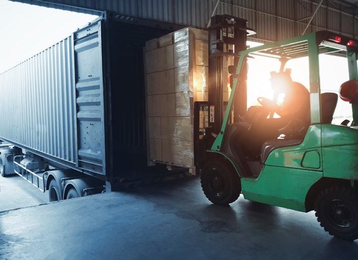 forklift loading a trailer